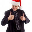 Young man wearing christmas hat — Stock Photo #1349905