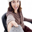 Royalty-Free Stock Photo: Woman in christmas hat opearting remote