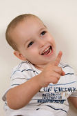 Pleased boy pointing upwards — Stock Photo