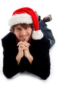 Smiling male wearing christmas hat — Stock Photo