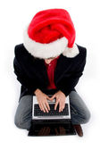 Christmas boy working on laptop — Stock Photo