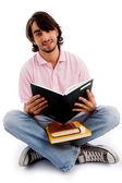 Ung student upptagen med sina böcker — Stockfoto