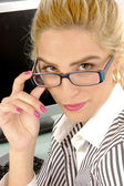 Businesswoman holding eyewear — Stock Photo