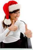 Christmas woman with thumbs up — Stockfoto