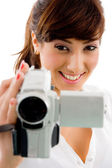 Young female holding camcoder — Stock Photo