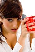 Woman holding coffee mug — Stock Photo