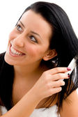 Young woman combing her hair — Stock Photo