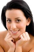 Smiling young woman looking at camera — Stock Photo
