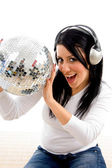 Female listening music with disco ball — Stock Photo