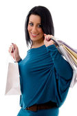 Smiling model with carry bags — Stock Photo