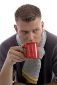 Handsome young man drinking coffee — Stock Photo