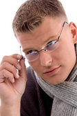 Young man holding eye wear — Stock Photo