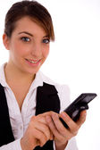 Young female holding cell phone — Stockfoto
