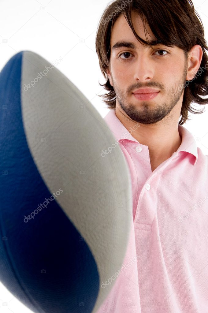 Young man with rugby ball on an isolated white background  Stock Photo #1347138