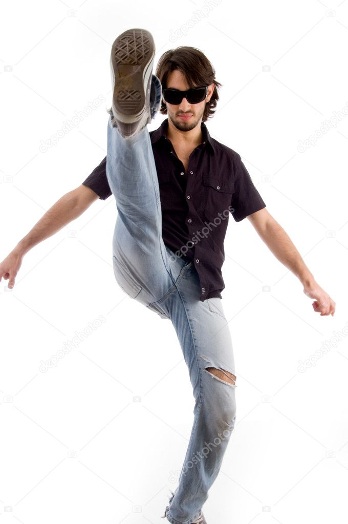 Smart male kicking high with white background — Zdjęcie stockowe #1347161