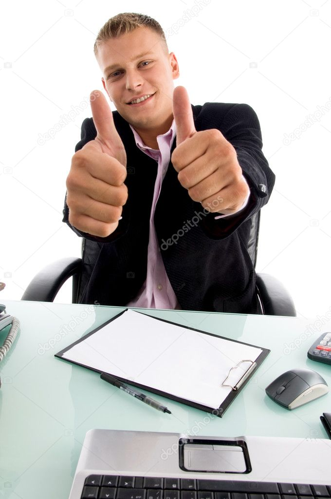 Smiling boss showing thumbs up with both hands in an office  — Stock Photo #1347196