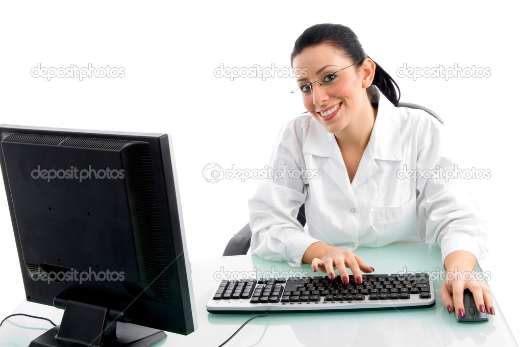 Front view of smiling doctor working on computer on an isolated white background  Stockfoto #1348416