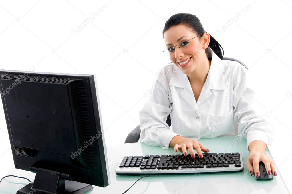 Front view of smiling doctor working on computer on an isolated white background — Stok fotoğraf #1348416