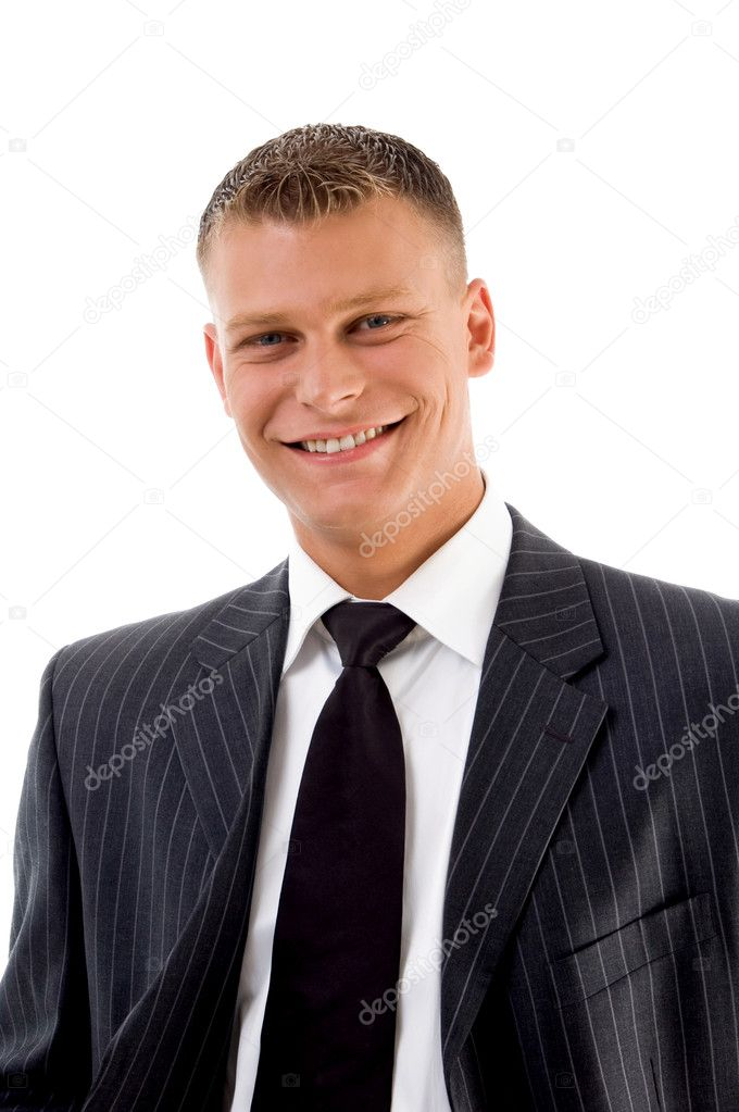 Portrait of smiling handsome businessman against white background — Lizenzfreies Foto #1349509