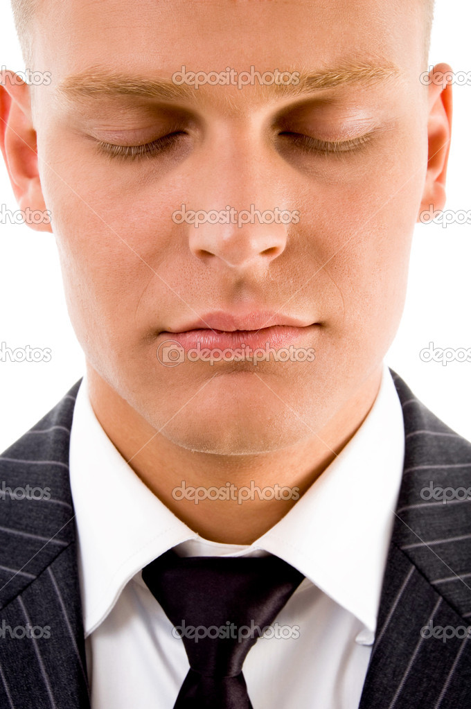 Man posing with closed eyes on an isolated background — Stock Photo #1349661