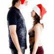 Christmas couple facing each other — Stock Photo