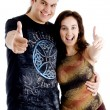 Couple with thumbs up and smiling — Stock Photo