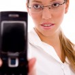 Portrait of female showing cell phone — Stock Photo