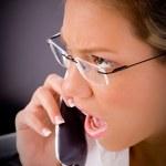 Female lawyer talking on phone — Stock Photo