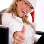 Beautiful woman wearing christmas hat — Stock Photo