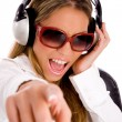 Female enjoying music and smiling — Stock Photo