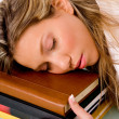 Young lady sleeping on books — Stock Photo
