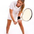 Young tennis player holding racket — Stock Photo
