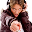 Young woman enjoying loud music — Stock Photo