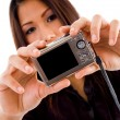 Royalty-Free Stock Photo: Attractive asian woman holding camera