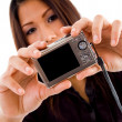 Attractive asian woman holding camera - Stock Photo