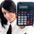 Stock Photo: Young woman showing calculator