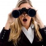 Young woman eyeing with binoculars — Stock Photo #1351099