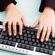 Professional fingers working on keyboard — Stock Photo