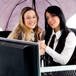 Executives holding an umbrella — Stock Photo #1351125