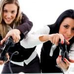 zusters spelen van videospellen — Stockfoto
