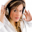 Beautiful woman enjoying music — Stock Photo