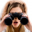 Beautiful woman watching with binoculars — Stock Photo