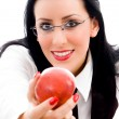 Young woman offering an apple — Stock Photo