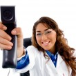 Smiling doctor showing phone receiver — Stock Photo