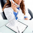 Medical professional talking on phone — Stock fotografie