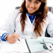 Royalty-Free Stock Photo: Smiling doctor writing prescription