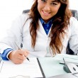 Smiling doctor writing prescription — Stock Photo #1351450