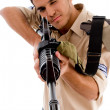 Young soldier aiming with gun - Stock Photo