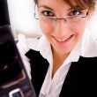 Smiling businesswoman showing cellphone — Stock Photo