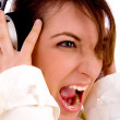 Screaming woman listening to music — Stock Photo #1352014